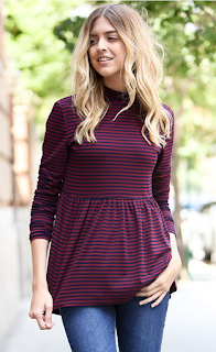 http://shoptwodots.com/product/long-sleeve-ruffle-top/