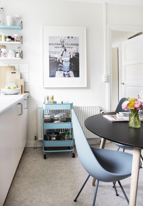 scandinavian apartment kitchen decor, white kitchen cabinets,flowers decor,  modern design chairs