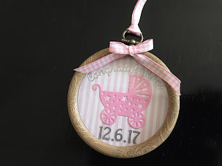 Hand made new baby gift with shaker dome and embroidery hoop
