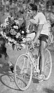 Alfredo Binda is presented with a  bouquet after the 1933 Giro