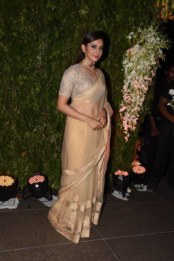 Rakul Preet Photos In Yellow Saree At Wedding Reception