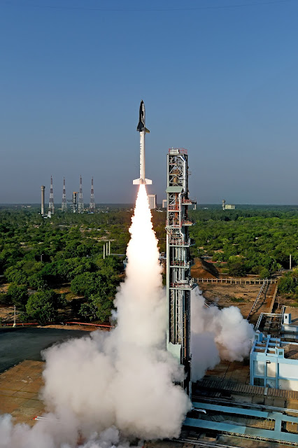 The Reusable Launch Vehicle-Technology Demonstrator (RLV-TD) took to the skies from the First Launch Pad at Satish Dhawan Space Centre, Sriharikota atop an HS9 solid rocket booster. Liftoff occurred at 7:00 a.m. local time (9:30 p.m. EDT on Sunday, May 22). Credit: ISRO