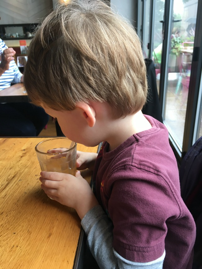 Our-Weekly-Journal-31st-July-2017-Sun-and-Rain-toddler-at-Jamies-Restaurant-drinking-squash