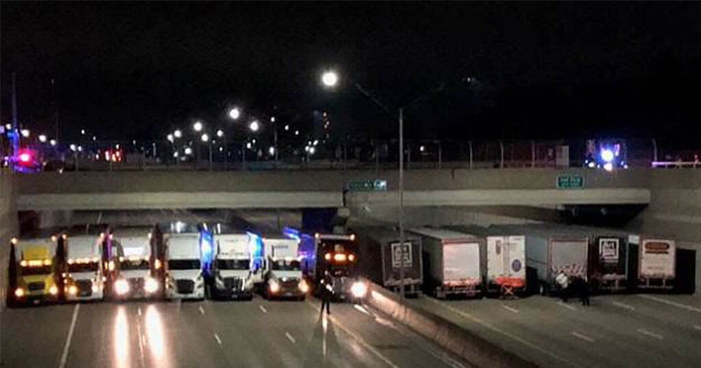 Police Trucks Parked Under A Bridge To Prevent A Man From Committing Suicide
