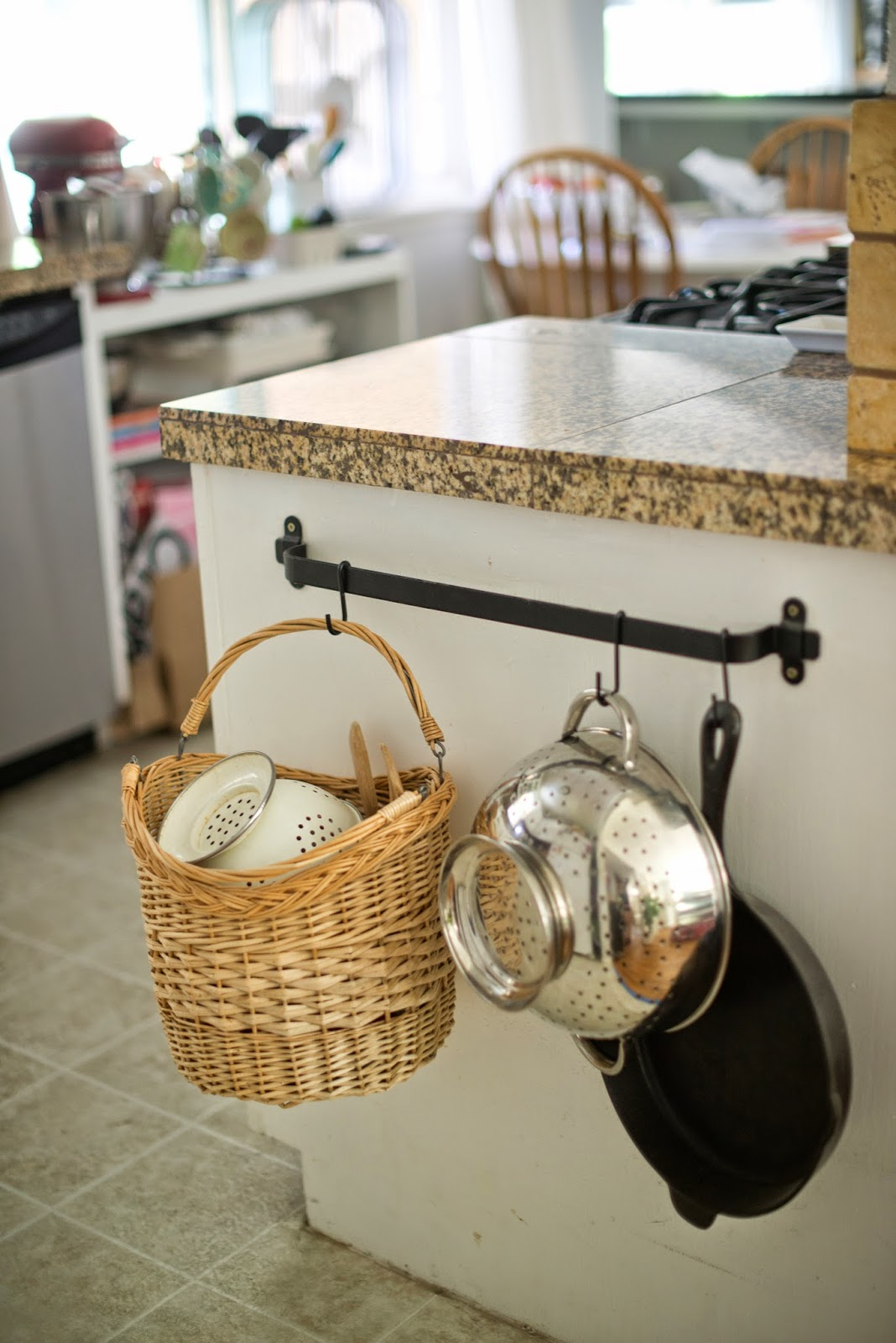 Use a towel bar to hold kitchen supplies. A cute way to organize the kitchen.