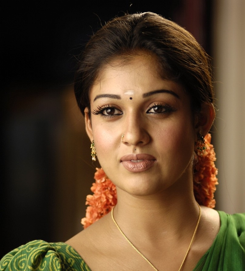 Nayantara Hot Face Close Up Stills In Green Saree