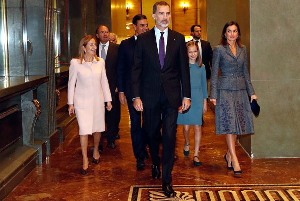 Queen Letizia wore Felipe Varela suit and Magrit Pumps, carried Hugo Boss Fanila clutch bag, Leonor and Sophia Carolina herrera dress