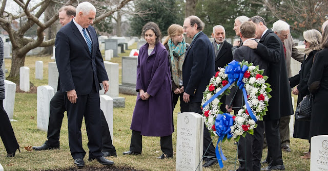 "Vice President Mike Pence observes the grave marker of Virgil ""Gus"" Grissom from Apollo 1, after a wreath laying ceremony that was part of NASA's Day of Remembrance, Thursday, Feb. 7, 2019, at Arlington National Cemetery in Arlington, Va. Wreaths were laid in memory of those men and women who lost their lives in the quest for space exploration. Photo Credit: (NASA/Aubrey Gemignani)"