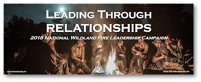 Leading through Relationships - 2018 National Wildland Fire Leadership Campaign (wildland firefighters sitting around a campfire)