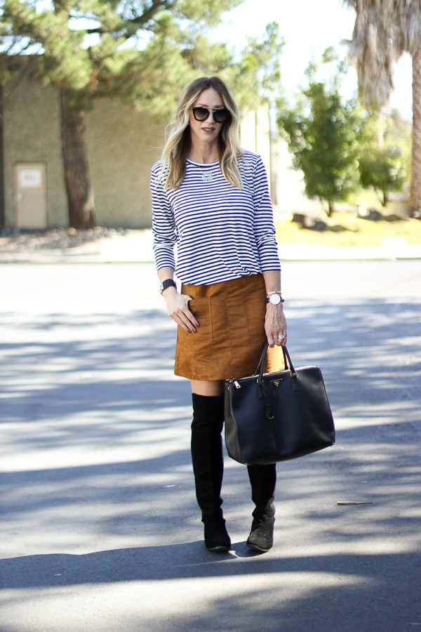 over the knee boots with a skirt