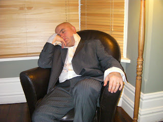 harry hill lookalike asleep in chair
