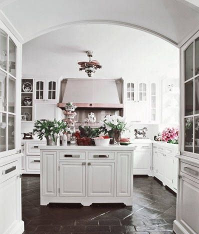 kitchen with terra cotta floor painted in black