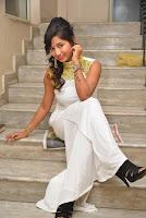 Actress Ishita Latest Stills in White Long Dress at Ippatlo Ramudila Seethala Evaruntaarandi Babu movie Audio Launch  011.jpg