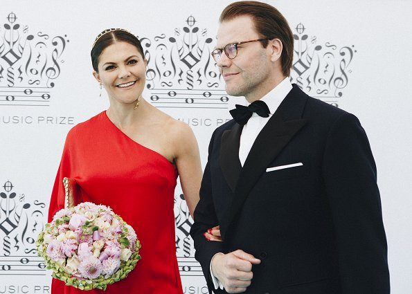 Princess Madeleine wore Giambattista Valli Green Garden Butterfly-print Tiered Silk-georgette Gown. Crown Princess Victoria wore Stylein One Shoulder red gown from Autumn Winter 18 Collection