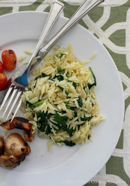 A quick and easy side dish - Lemon Garlic Orzo with Baby Spinach. Bright, zesty lemon with fresh garlic and fresh spinach.