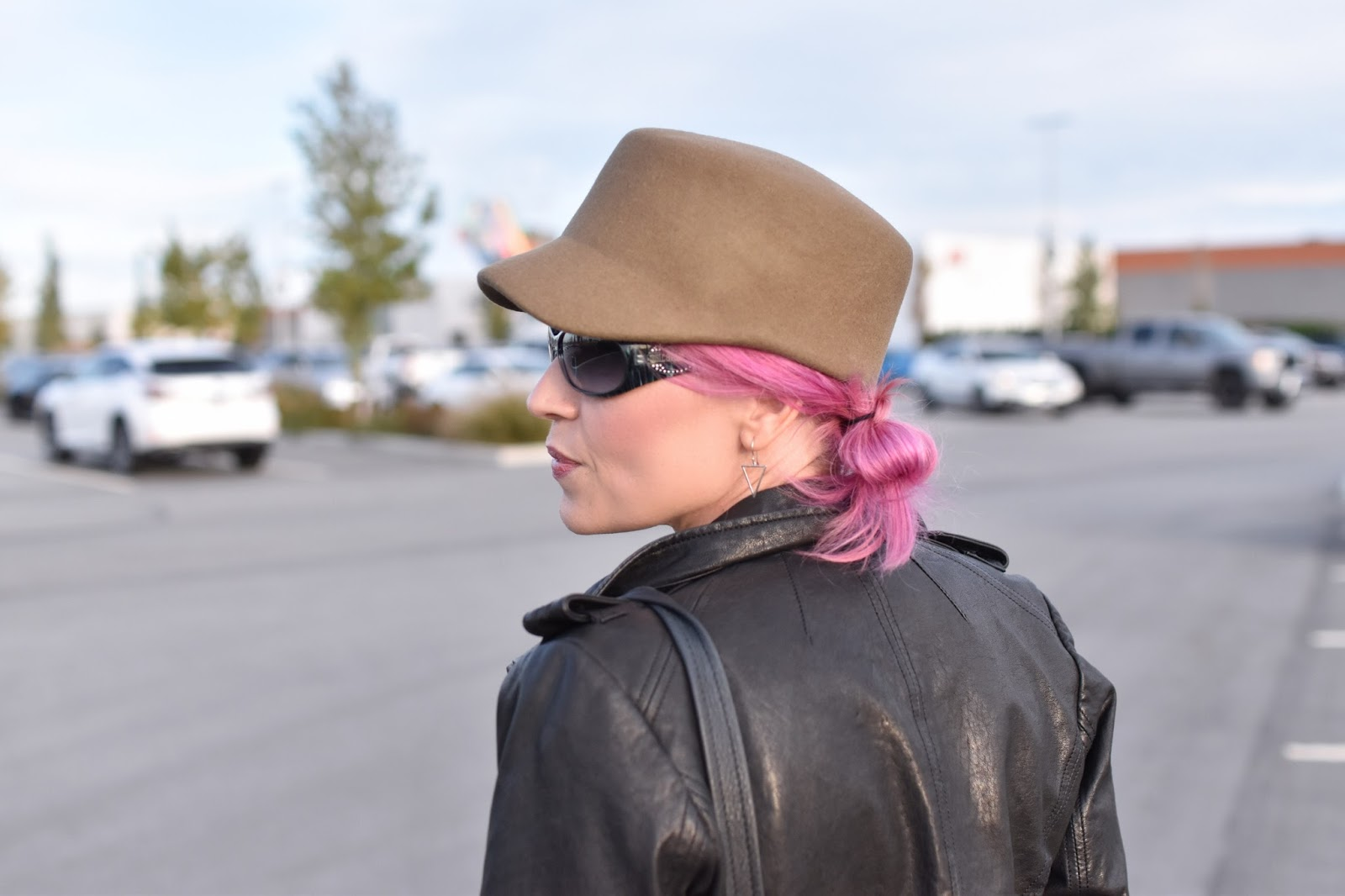 Monika Faulkner outfit inspiration - moto jacket, military-inspired felt cap, fuchsia hair