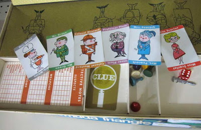 Contents of Clue box with character cards shown