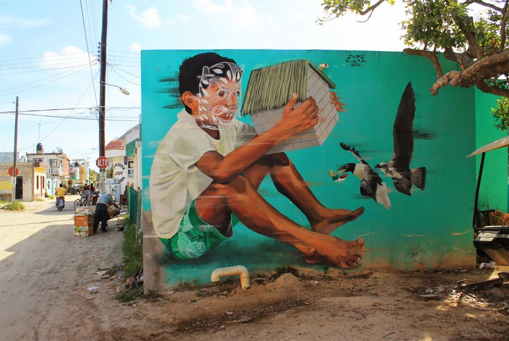 "Street Art festival IPAF is currently taking place in Holbox, an island in the Mexican state of Quintana Roo, located on the north coast of the Yucatán Peninsula. Peruvian muralist JADE is part of this year's line-up and he just finished working on this sweet new piece entitled ""El Guardian""."