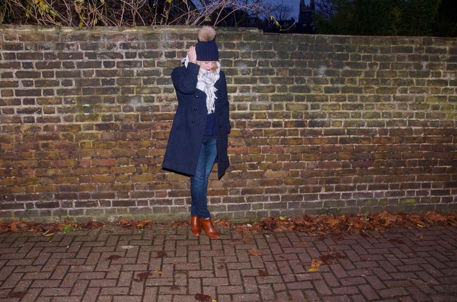 Navy coat, white checked scarf, jeans and brown boots
