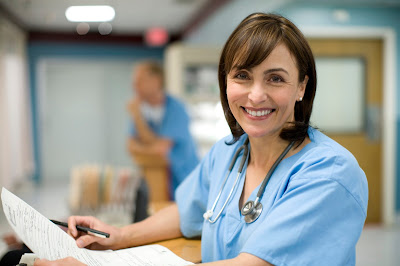 Photo of medical professional smiling while holding documents