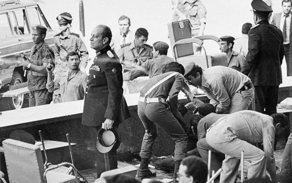 Egyptian soldiers tend to wounded after an attack on the reviewing platform which killed Egyptian President Anwar Sadat.