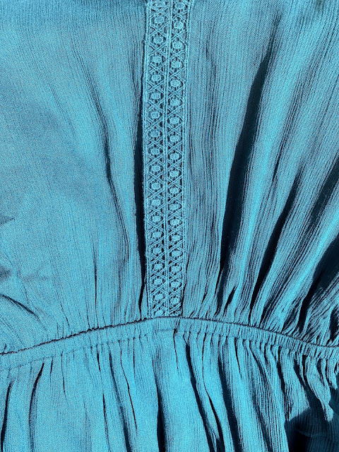 close up of elasticated waist and trim one teal maxi dress from Fashion World
