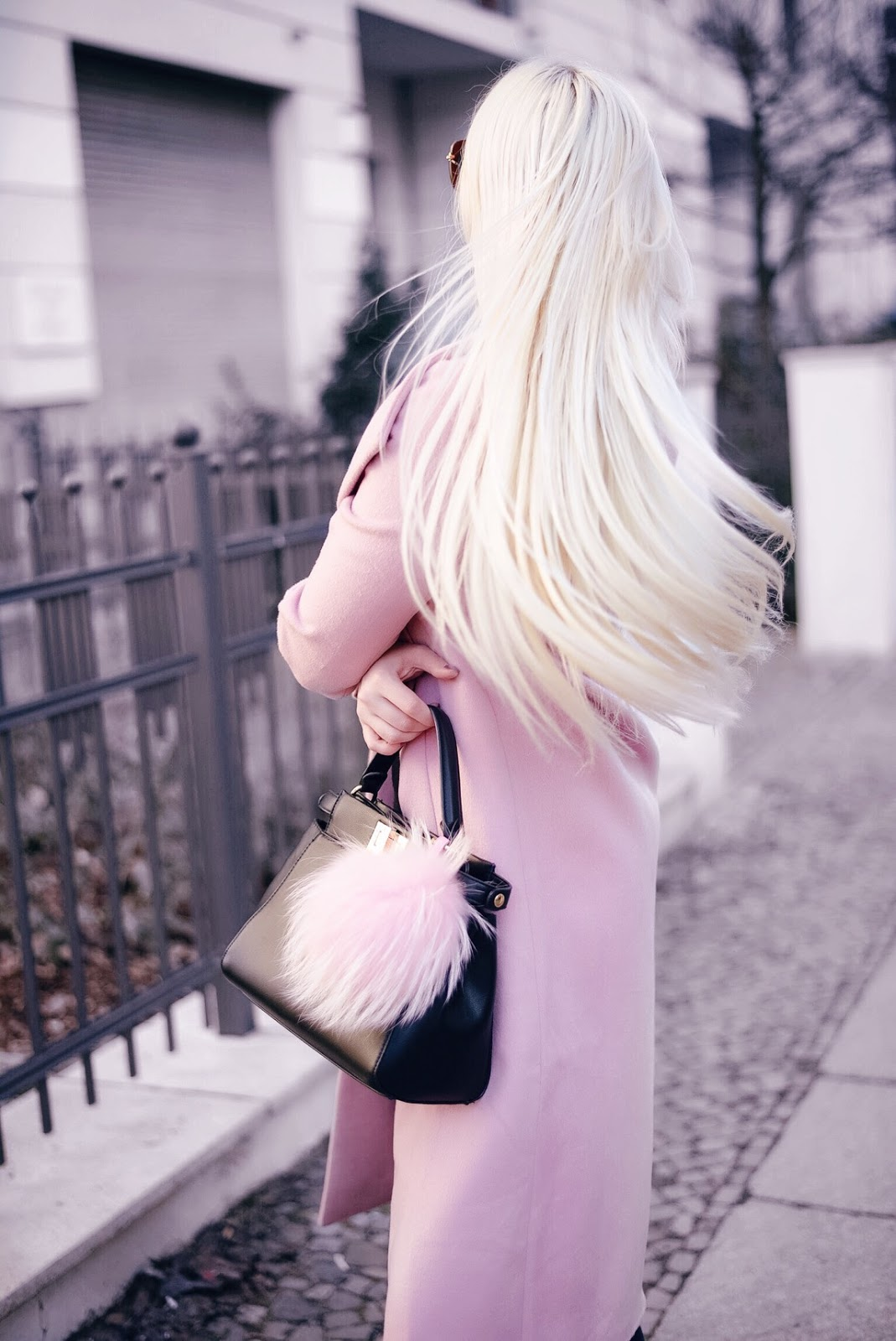 pink coat_winter streetstyle_long blonde hair