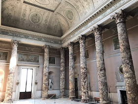 A room with marble pillars