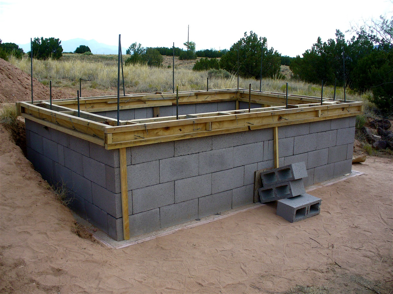 Alt build blog building a well house 2 dry stack for Foundation for homes