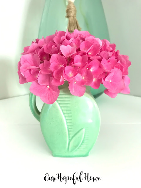 pink hydrangeas green pottery vase