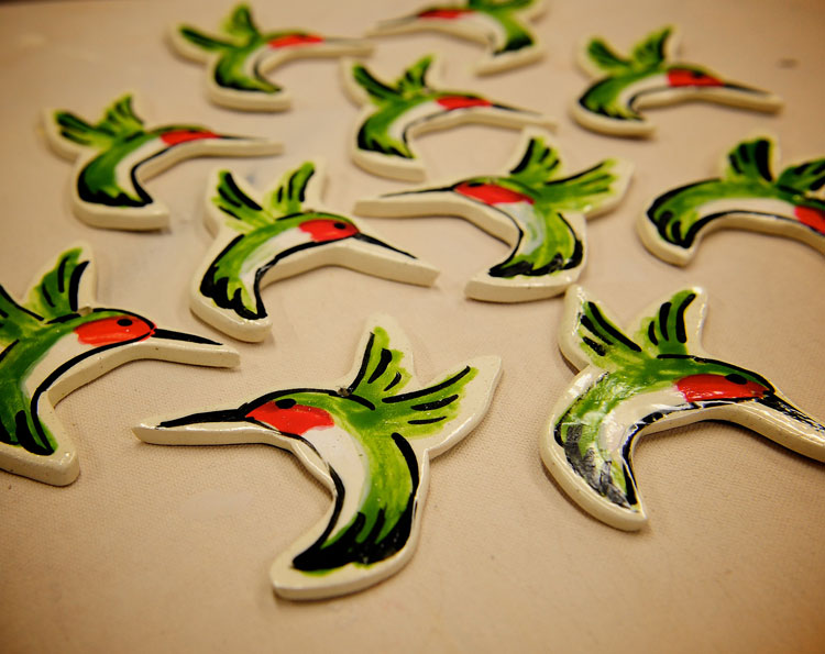 Ceramic pottery hummingbird ornaments fresh out of the kiln. It's an easy clay art project. Just follow these steps.