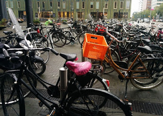 Bicycles parked in a plaza on a rainy day, Amsterdam, The Netherlands