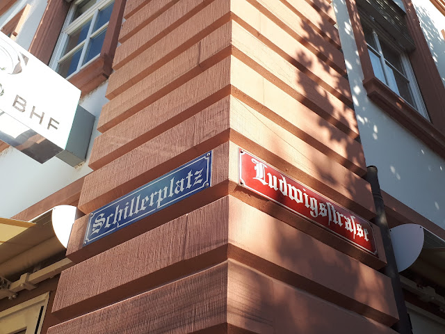 Blue and red street name signs in Mainz