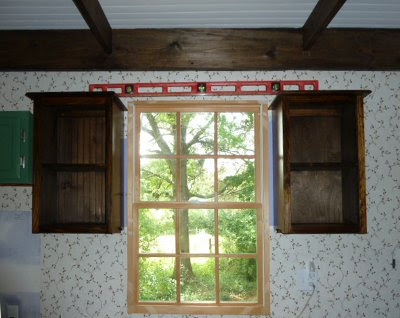 pair of Amish cabinets on either side of the kitchen window