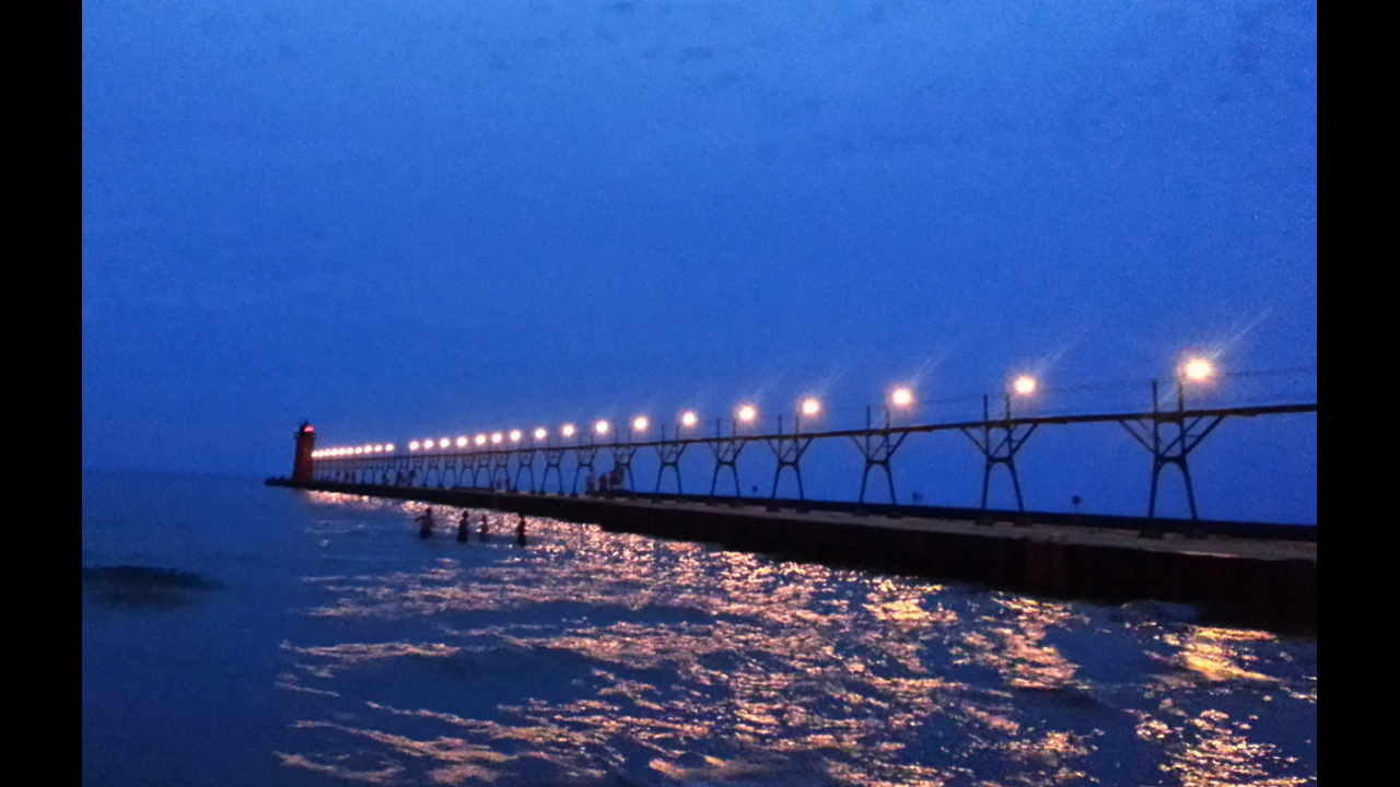 dusky dock lit up like a string of pearls