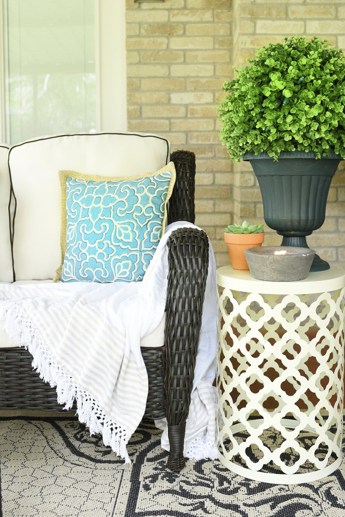 Outdoor patio set and decor in a beautiful brown and beige/ivory color palette with pops of color. | via monicawantsit.com