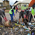Ex Beauty Queen & Her Team Defy Heavy Rainfall To Clean Abuja Street (See Photos)