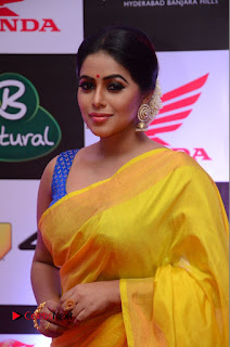 Actress Poorna Pictures in Yellow Saree at Mirchi Music Awards South 2015  0061