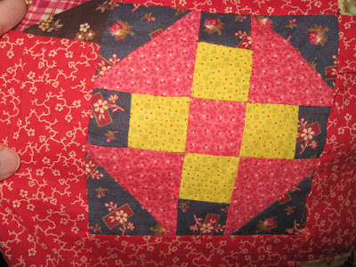 red and chrome yellow antique churndash quilt block