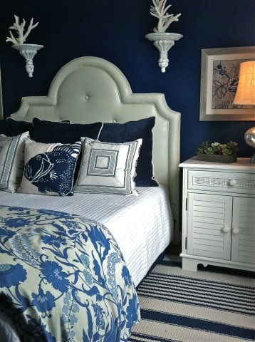 Dramatic Coastal Bedroom Design with Dark Blue Painted Walls