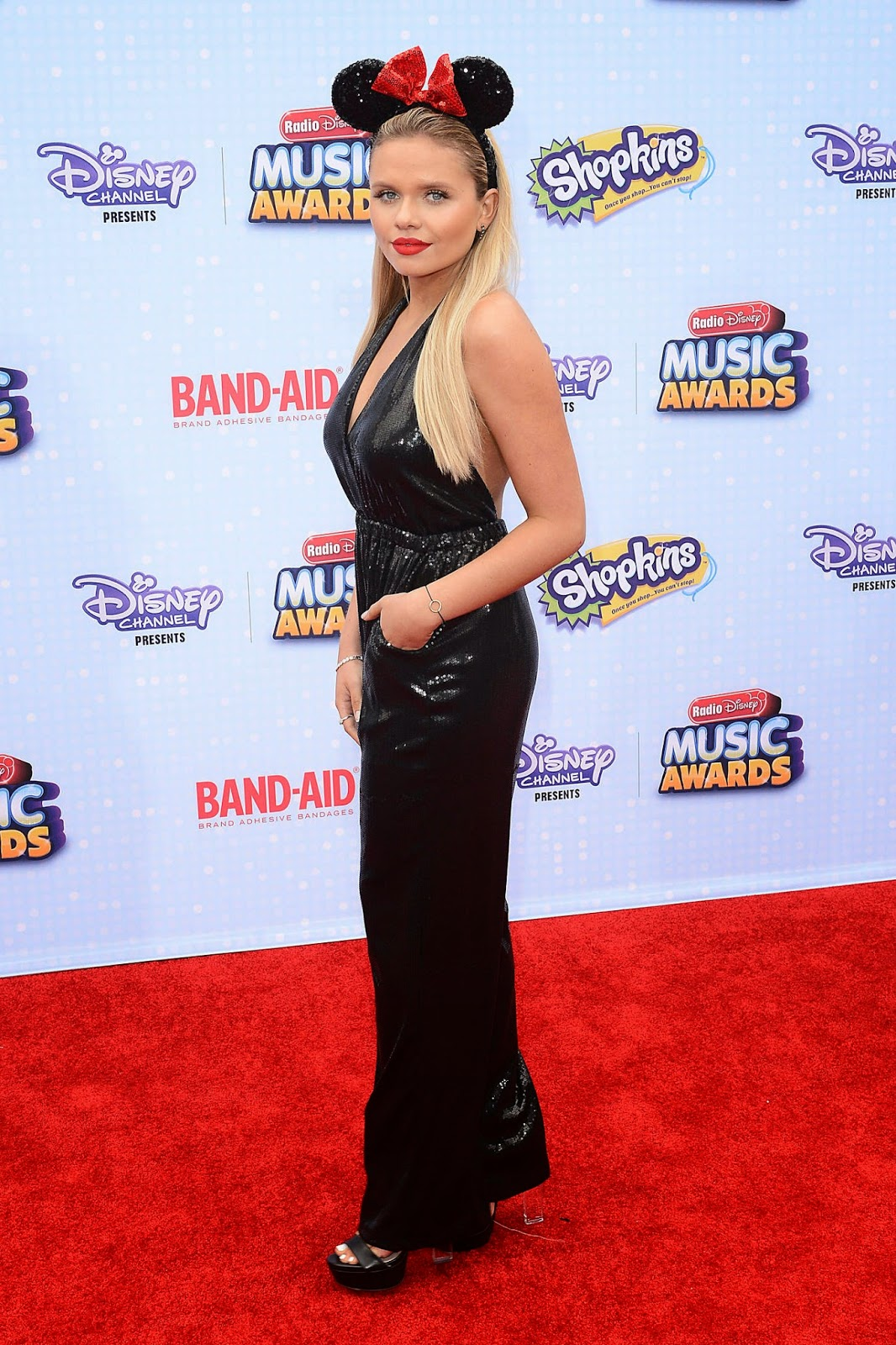 Alli Simpson in a shimmery black jumpsuit at the 2015 Radio Disney Music Awards in LA