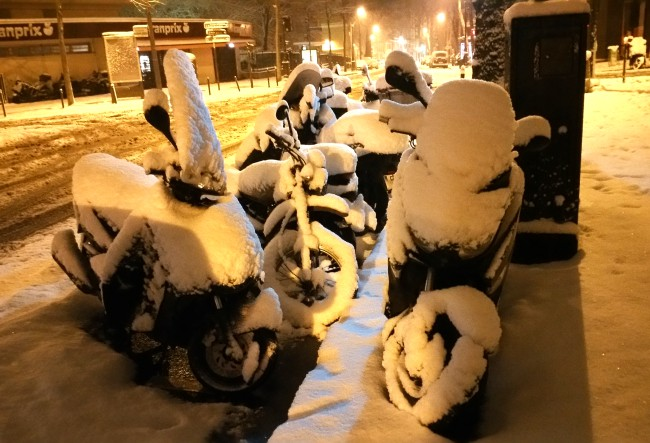 Motorbikes coated with snow...