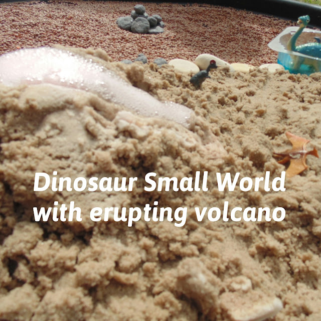 Dinosaur small world with erupting volcano
