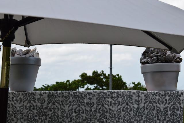 Outdoor patio Umbrella, Sunbrella, throws, Sea shells  By: JoFer Interiors