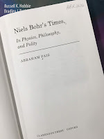 Niels Bohr's Times: In Physics, Philosophy, and Polity, by Abraham Pais, superimposed on Intermediate Physics for Medicine and Biology.
