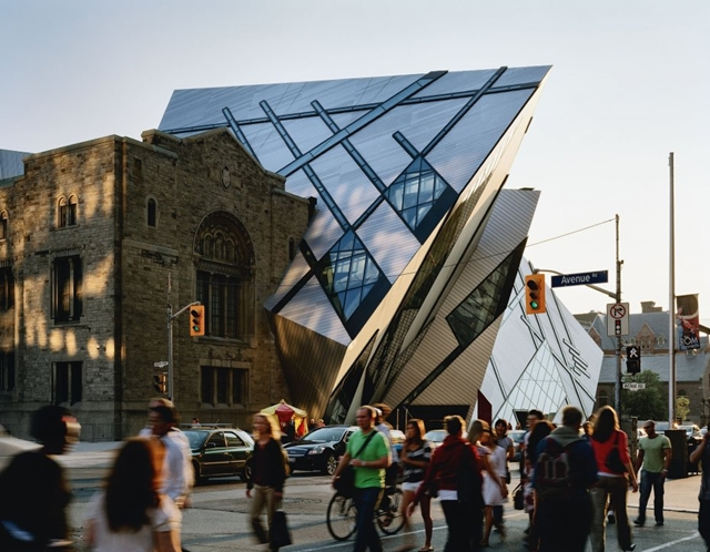 Royal Ontario Museum by Studio Daniel Libeskind as seen from the street along with pedestrians and trafic