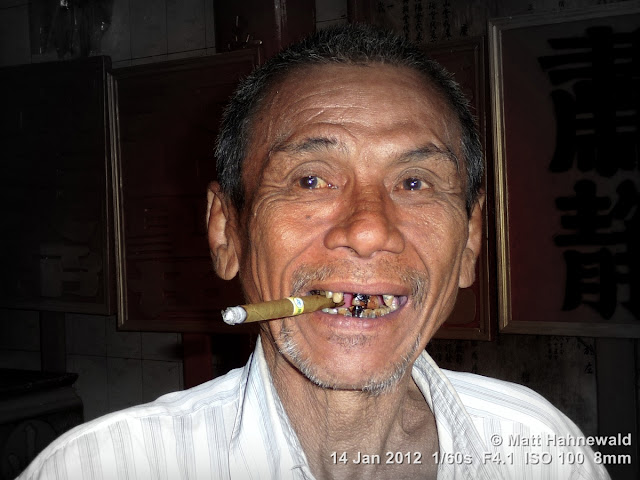 Burma, Myanmar, Yangon, Burmese man, people, street portrait, headshot, focal black and white, cigar, bad teeth
