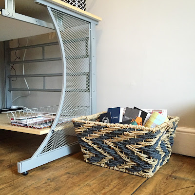 magazine storage basket in office