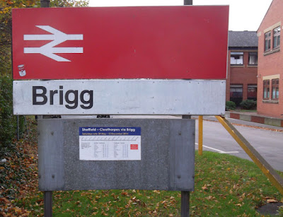 Old British Rail era sign showing the way to Brigg railway station for drivers and passengers on foot - picture on Nigel Fisher's Brigg Blog