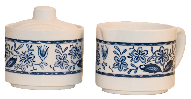 A 1970s creamer with sugar bowl, in a variation of the blue onion pattern.